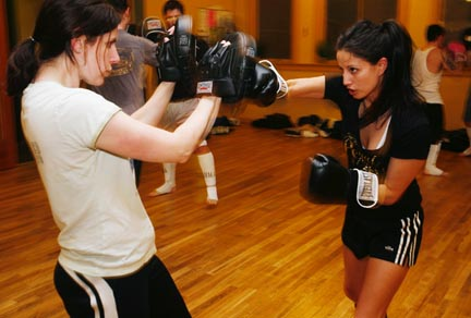 Felicia Molano, right, spars with Kari Neumeyer at the MMA class.