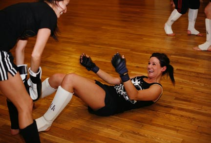 Amy Kruckeberg ends up on the floor during a sparring match with Felicia Molano.