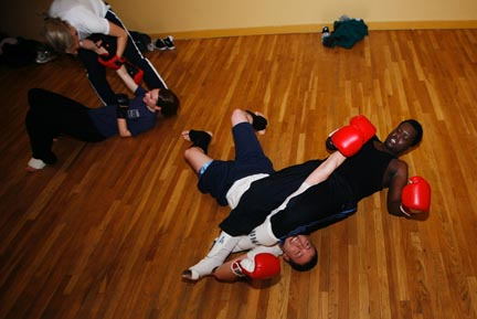Manis Pierre, right, applies the submission move of a straight armbar on Ian Chambers.