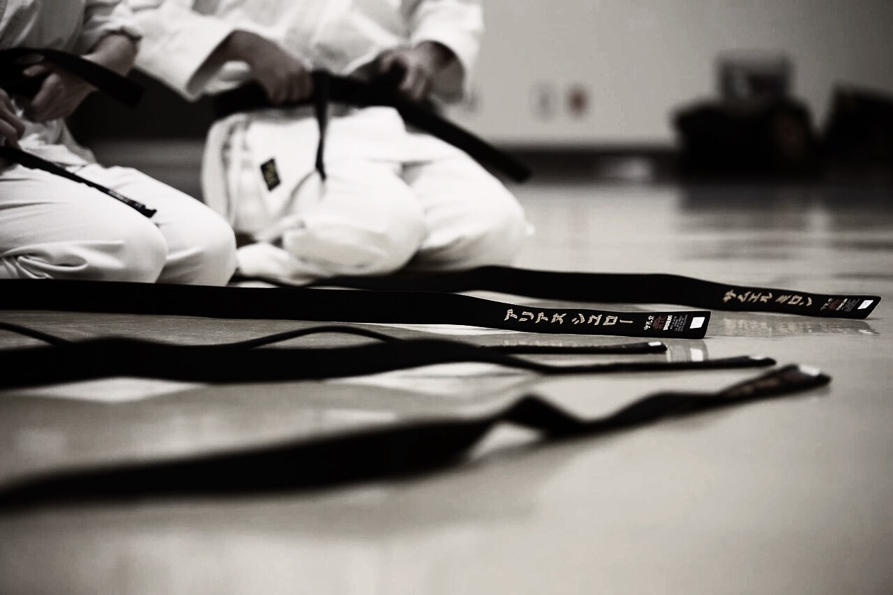 black-belt-kneeling